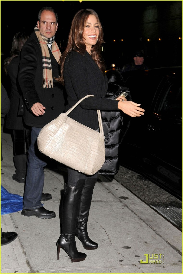 "Sofia Vergara, carrying a snake skin bag and wearing high heel boots, stops for a photograph after making an appearance on ""The Late Show with David Letterman"""